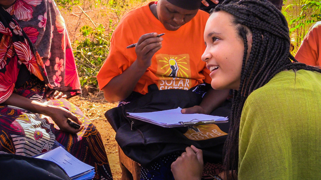 Allen helps a group of Solar Sister entrepreneurs with their surveys following a focus group in rural Tanzania this summer. (Photo by Serena Chan)