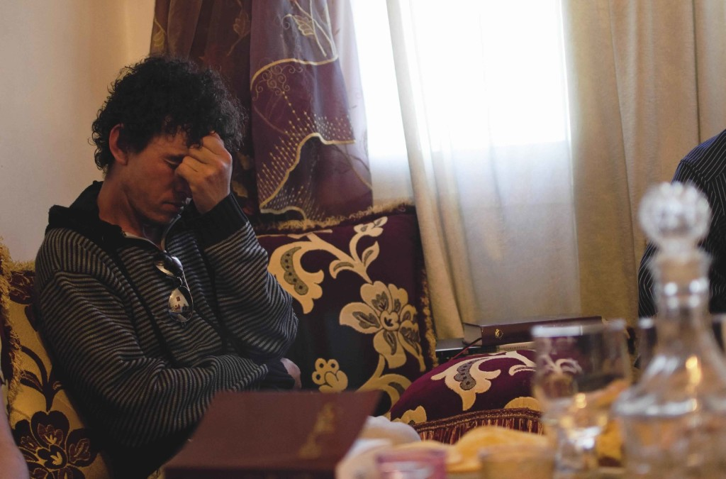 While another member of the his church discusses the lack of Christian rights in Morocco, Hassan, 27, begins to cry.  (Photo by Julia Levine