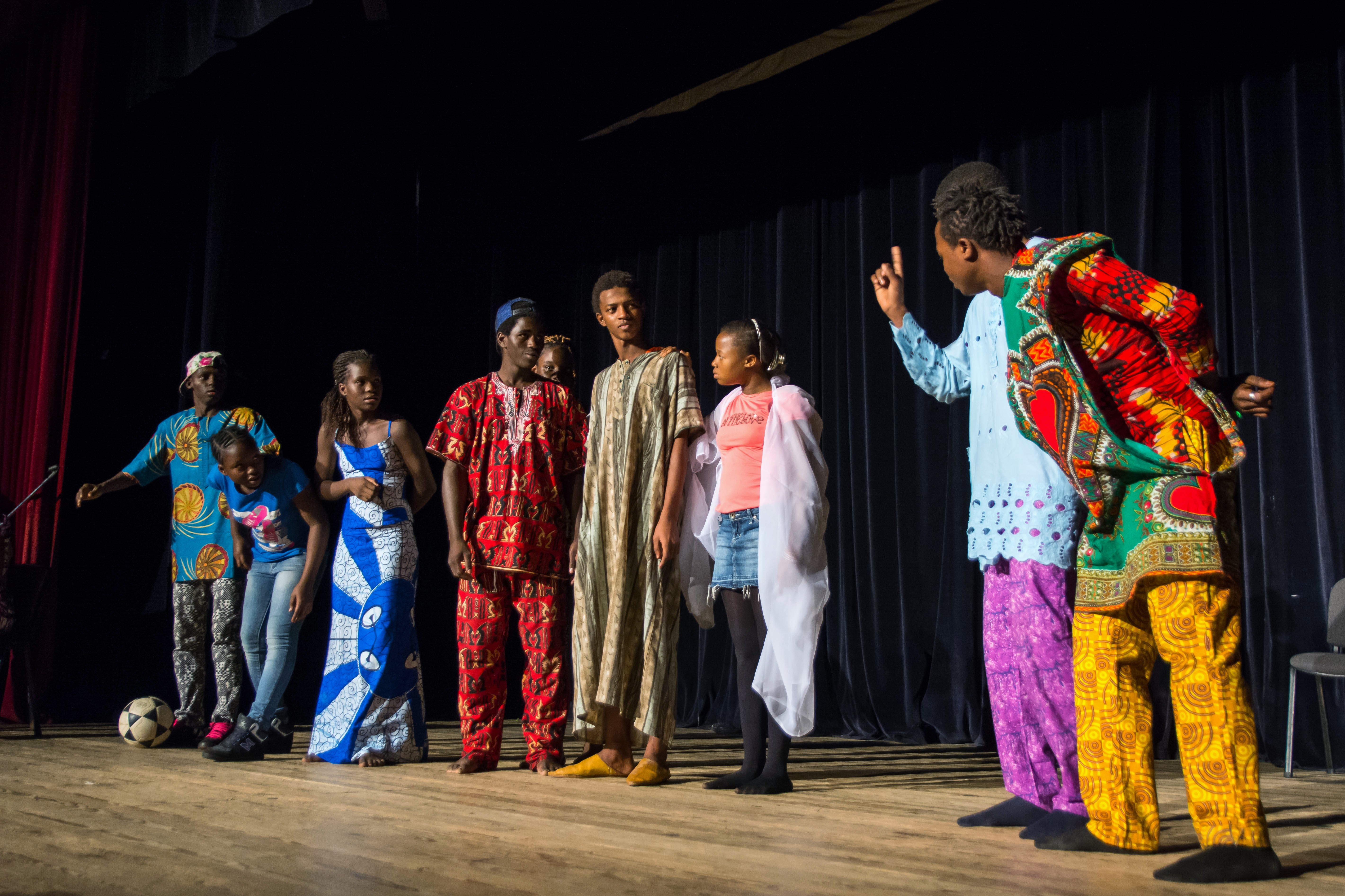 Young migrants from Senegal, The Ivory Coast, and The Democratic Republic of the Congo perform a play at the Migrant en Scene festival in Rabat on November 18, 2015. The play, written by Moroccan school students, told the story of a group of villagers that reject a man because of the color of his skin. Photo by Hannah Steinkopf-Frank.