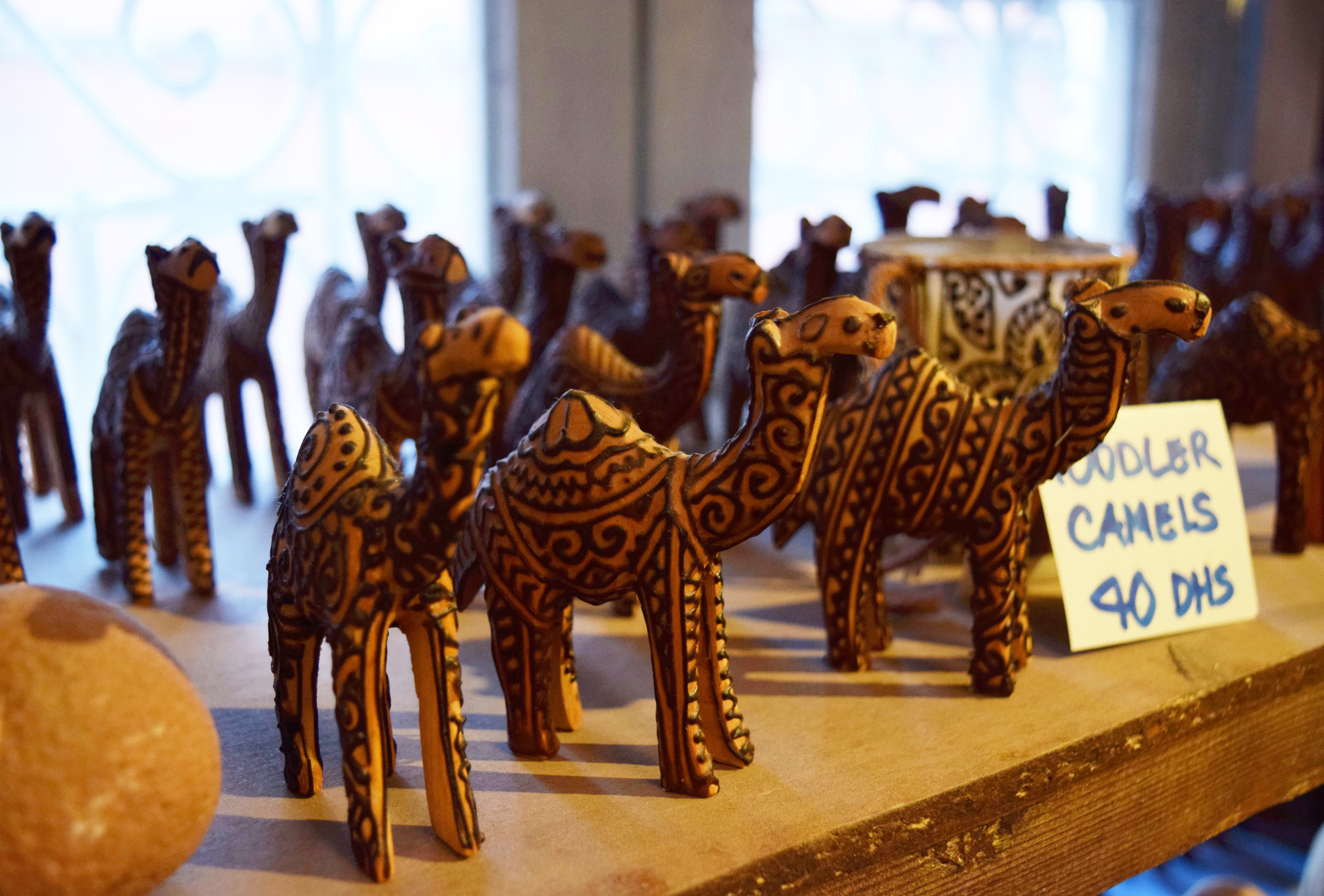 One of the many things the henna artists apply their craft to, these hand-carved camels are the best selling items in the cafe's boutique. Photo by Regan Reeck.
